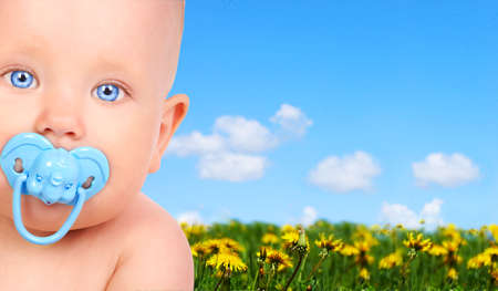 Sweet smiling baby in the summer park  photo