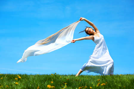 Freedom. Happy young woman running  in the field  Stock Photo