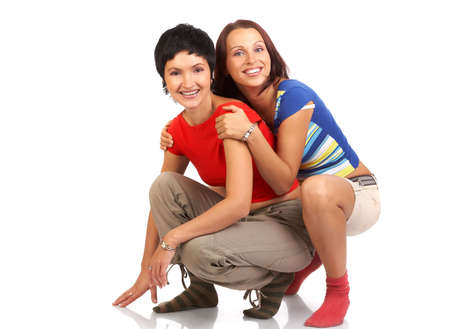 Happy young women friends smiling.  Over white background Stock Photo - 3663602