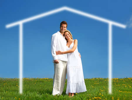 Young love couple smiling under blue sky.  Real estate concept Stock Photo - 3754901