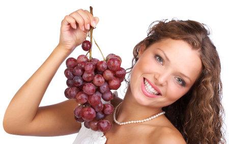 nourish: Beautiful young woman with bunch of grape.  Stock Photo