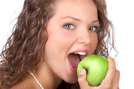 Beautiful young woman with a green apple. Isolated over white  photo