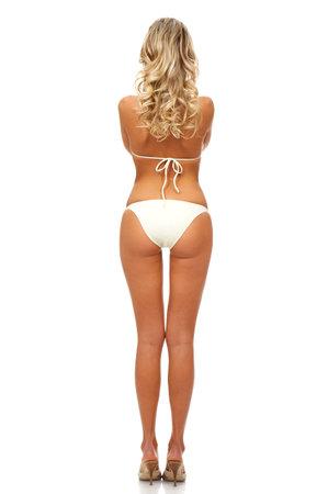 nalga: Sexy rubia mujer. Aislado sobre fondo blanco