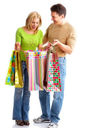 Shopping  smile couple. Isolated over white background Stock Photo - 3784566