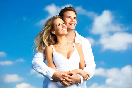 Young love couple smiling under blue sky Stock Photo - 3784477