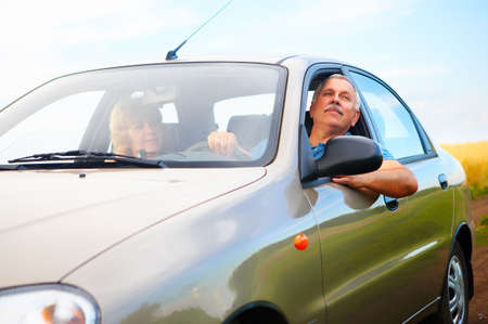 Smiling happy elderly couple  in the new car Stock Photo - 3784410