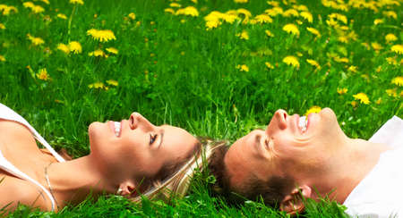 Young love couple sleeping on green grass Stock Photo - 3784639