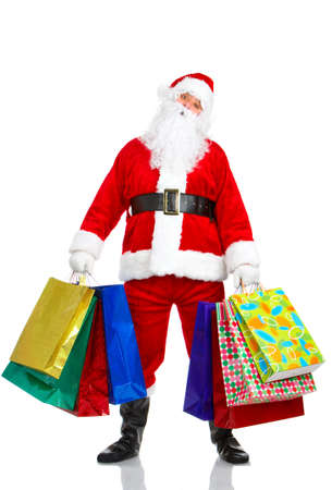 Shopping Christmas Santa. Isolated over white background  photo
