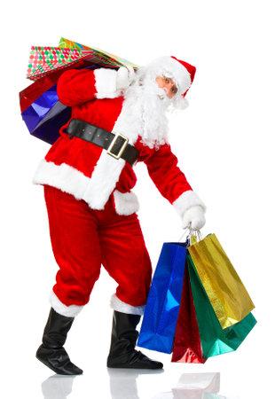 Shopping Christmas Santa. Isolated over white background  photo