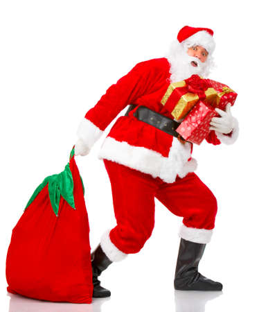 Happy Christmas Santa with gifts. Over white background  photo