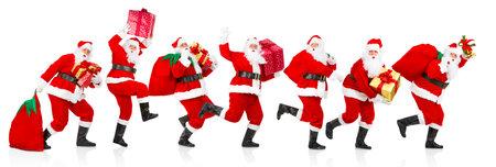 ハッピー ランニング クリスマス サンタ。白い背景の上の分離
