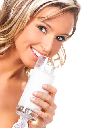 Young happy woman  drinking milk. Over white background    photo