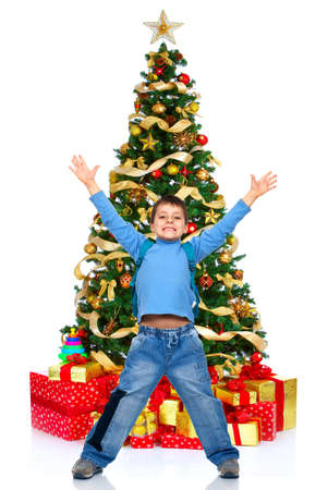 Boy and a Christmas Tree. Over white background Stock Photo - 3853864