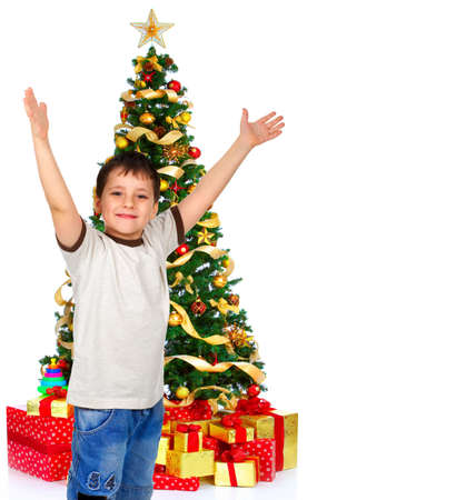 Boy and a Christmas Tree. Over white background Stock Photo - 3853863