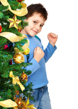 Boy and a Christmas Tree. Over white background Stock Photo - 3853861