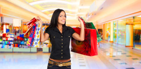 Shopping smiling woman in the mall  Stock Photo