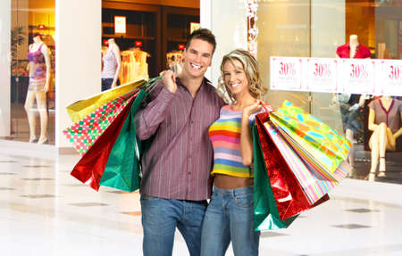 Shopping smiling couple in the mall