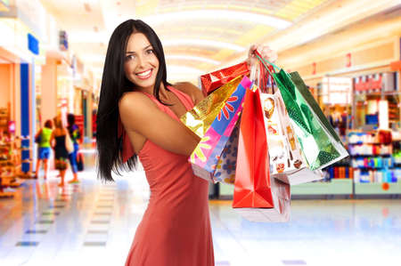 beauty shop: Shopping smiling woman in the mall  Stock Photo
