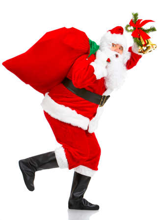 Happy running Christmas Santa. Isolated over white background  photo