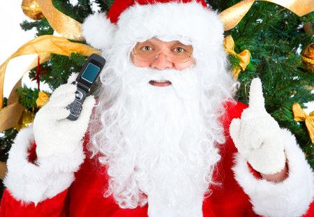 Smiling Santa, cellular, christmas tree. Over white background  photo