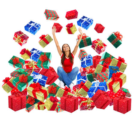 Happy woman and Christmas Presents. Over white background  photo