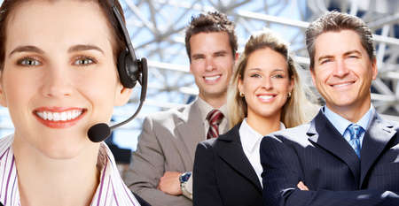 Smiling  business woman with headset and business team Stock Photo
