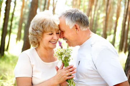 Smiling happy  elderly couple in love outdoor Stock Photo - 3934212