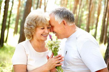 Smiling happy  elderly couple in love outdoor Stock Photo - 3934212