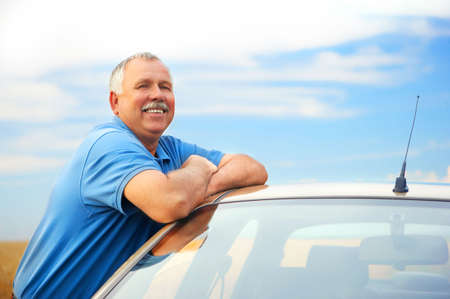 pollution free: Smiling happy elderly man  in the new car