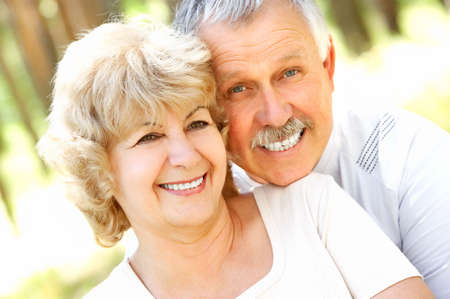 Smiling happy  elderly couple in love outdoor   photo