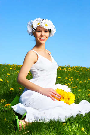 Beautiful woman with  flower under blue sky  photo