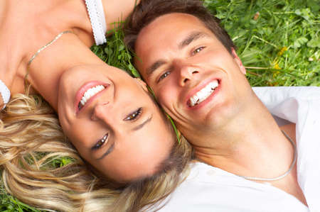 Young love couple sleeping on green grass Stock Photo - 3934289