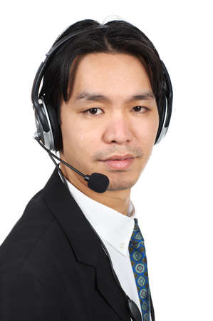 Smiling  businessman  with headset. Over white background   photo