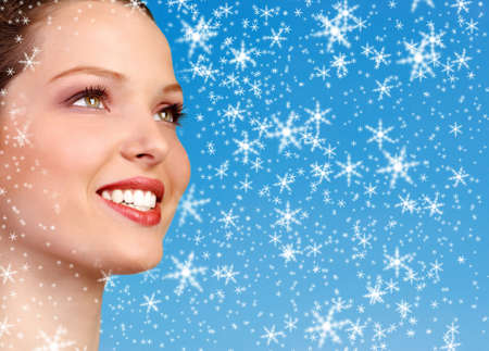 teeth whitening: Beautiful young smiling woman. Over blue background