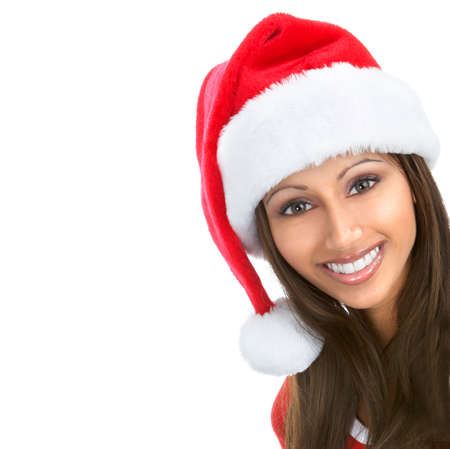 Christmas woman in a Santa Cap. Isolated over white background  photo