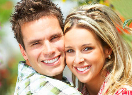 Young  happy smiling couple in love  photo
