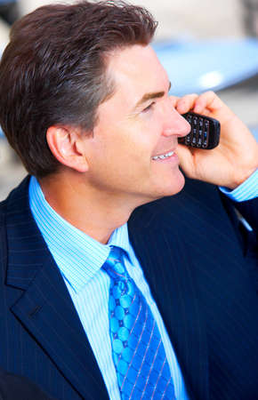 Businessman calling by cellular  photo