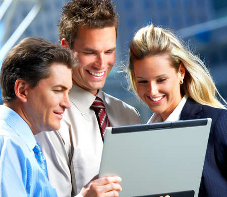Smiling business people working with laptop Stock Photo - 3982079