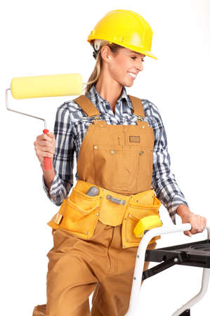 Young builder woman in yellow uniform. Isolated over white background  photo