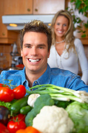 Young love couple cooking in the kitchen Stock Photo - 4023282