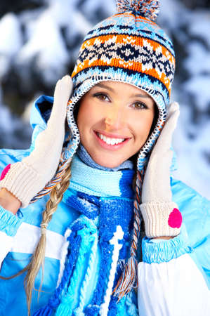 Beautiful happy woman in the winter forest  photo