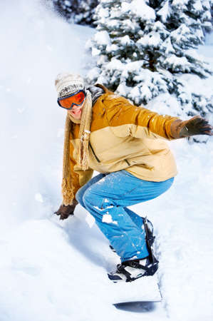 winter fashion: Young  happy smiling man with snowboard. Winter sport  Stock Photo