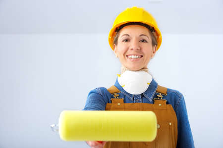 Young builder woman in yellow uniform. photo