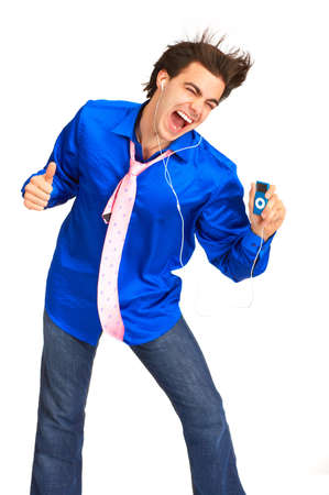 Happy young man with mp3-player. Over white background Stock Photo - 4080289