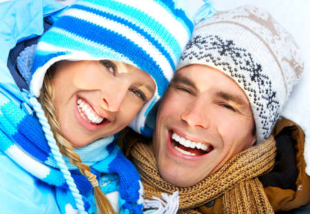 Young  happy smiling couple in love. Winter  photo