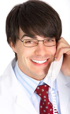 Smiling medical doctor calling by phone. Over white background Stock Photo - 4080266