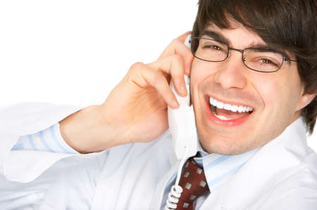 Smiling medical doctor calling by phone. Over white background Stock Photo - 4080257
