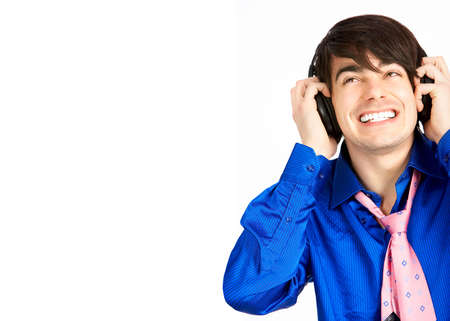 Happy young man with headset. Over white background Stock Photo - 4080330