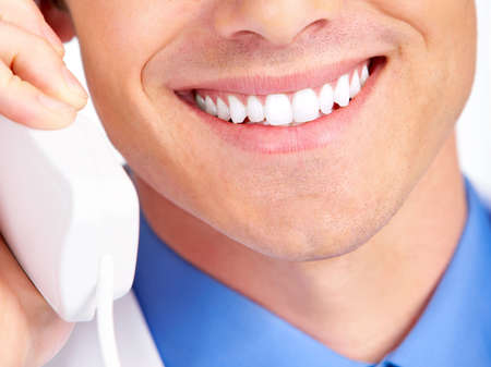 Smiling medical doctor calling by phone. Over white background Stock Photo - 4080209