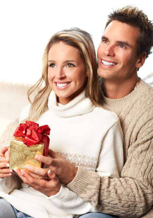 Young  happy smiling couple in love. Christmas  photo